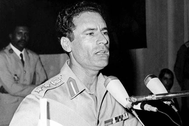 "Local Input~ TRIPOLI, LIBYA:  Post 1969 picture of Libyan Head of State Colonel Moamer Kadhafi. Kadhafi, born in 1942, formed in 1963 the Free Officers Movement, a group of revolutionary army officers, which overthrew 01 September 1969 King Idris of Libya and proclaimed Libya, in the name of ""freedom, socialism and unity,"" Socialist People's  Jamahiriya. (Photo credit should read AFP/Getty Images)"