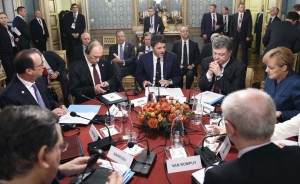 Leaders sit during a meeting on the sidelines of a Europe-Asia summit in Milan