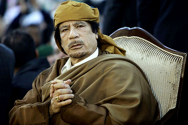 File photograph of Libyan leader Muammar Gaddafi attending a ceremony marking the birth of Islam's Prophet Mohammed in Tripoli